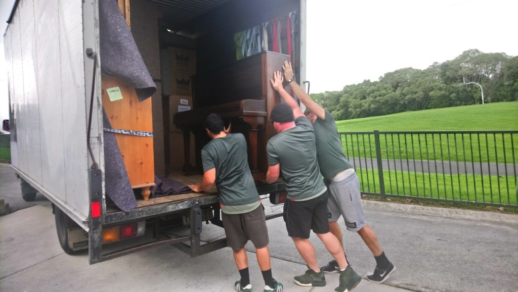 Auckland Moving Guys loading Piano